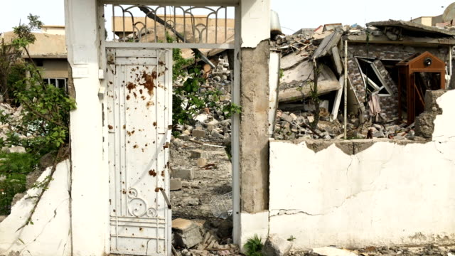 A house destroyed by fighting in west Mosul Iraqi forces backed by US and British air support have entered their sixth month of fighting as they...