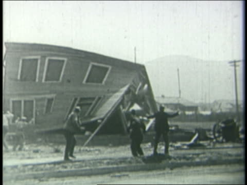 b/w 1924 house falling as men run towards camera - bad condition stock videos and b-roll footage