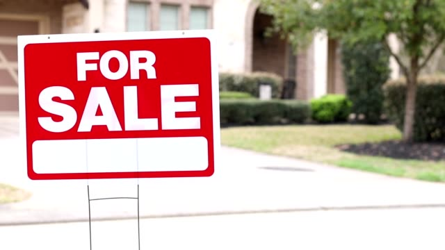 house for sale with real estate sign in yard. - residential district stock videos & royalty-free footage