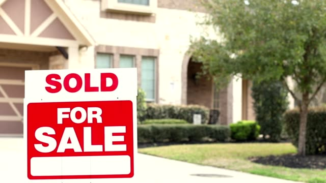 house for sale with real estate sign in yard. - selling stock videos & royalty-free footage