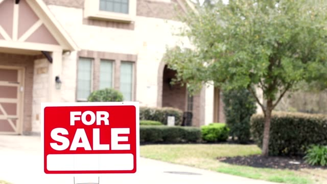 house for sale with real estate sign in yard. - real estate stock videos & royalty-free footage