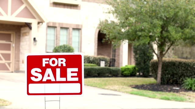 house for sale with real estate sign in yard. - sign stock videos & royalty-free footage