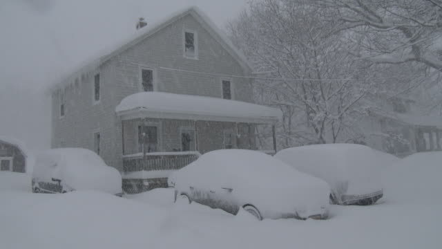 a house in adams new york along with vehicles in the driveway are buried under three feet of snow during a heavy lake effect snowstorm - scott mcpartland stock videos and b-roll footage