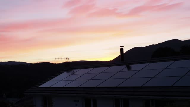 house in ambleside with solar panels at sunset on may 24, 2021 in ambleside, lake district, england. - glowing stock videos & royalty-free footage