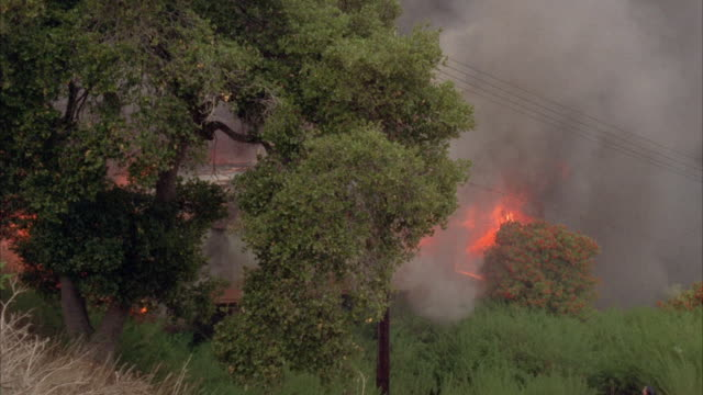 MS PAN House in fire on hillside during California brush fire / California, USA