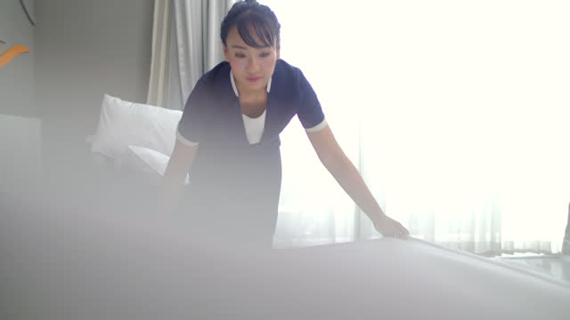 house keeper making the bed at the hotel - housework stock videos & royalty-free footage
