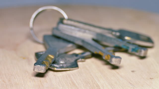 house keys laying on the wooden floor