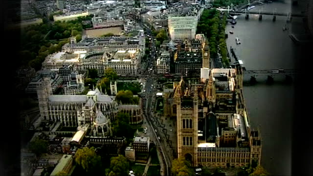 50 mps to lose their seats due to boundary changes england london views houses of parliament with graphic overlay - house of commons stock videos and b-roll footage