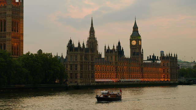 ws zo t/l house of commons and big ben with the thames / london, england, uk  - house of commons stock videos & royalty-free footage