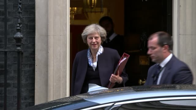 london downing street ext theresa may mp along from number ten and into car then car away - number 10 stock videos & royalty-free footage