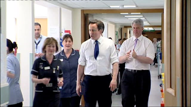 house of commons passes nhs reforms lib david cameron mp and lansley arriving in hospital ward with nurse - house of commons stock videos and b-roll footage