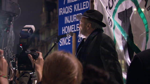 house of commons votes on air strikes in syria. shows exterior night shots george galloway addressing protesters at a stop the war rally. on december... - war stock-videos und b-roll-filmmaterial