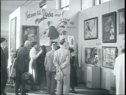 wa house of german art museum for nazi approved art / montage of entartete kunst degenerate art exhibition of works of art which had been deemed... - 1937 stock videos & royalty-free footage