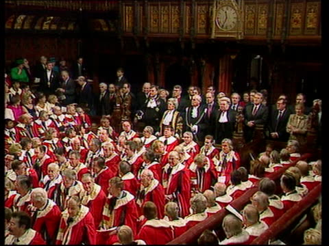 conservative split lib house of lords chamber chamber crowded for queens speech baroness jay in ceremonial gown crowded chamber with queen elizabeth... - the queen's speech state opening of uk parliament stock-videos und b-roll-filmmaterial
