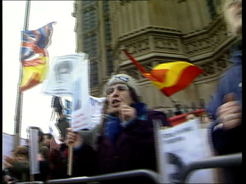 house of lords reserve judgement itn england london house of lords ext la gv woman protestor chanting and banging fist on railings pan to others next... - fist stock videos & royalty-free footage