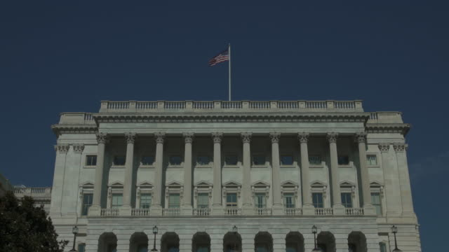 U.S. House of Representatives and American Flag in Washington, DC - Zoom Out - 4k/UHD