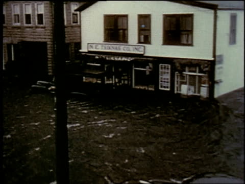 ws house on flooded street rushing water / new york city new york united states - anno 1957 video stock e b–roll