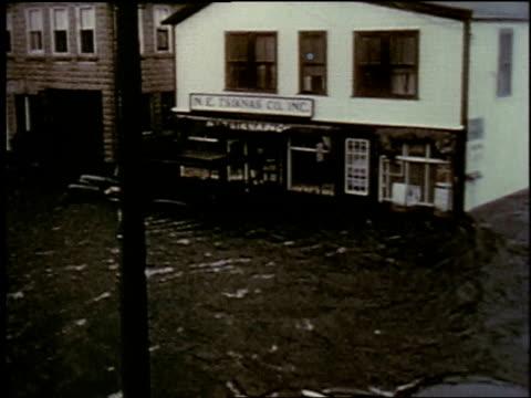 vídeos de stock e filmes b-roll de house on flooded street, rushing water / new york city, new york, united states - 1957