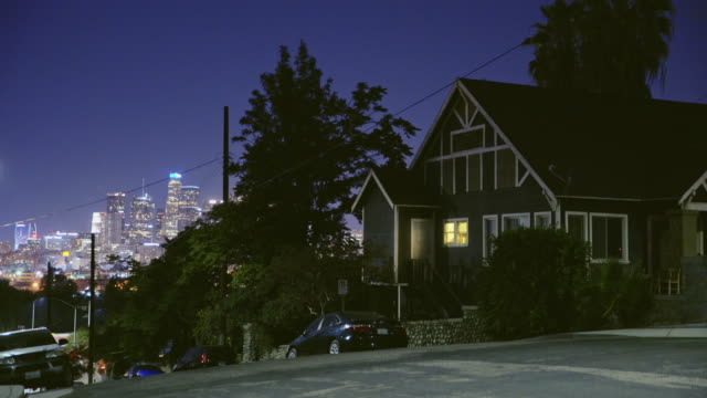 house on hill with skyline view - night - power line stock videos and b-roll footage