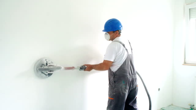 house painter sanding walls before painting. - decorating stock videos & royalty-free footage
