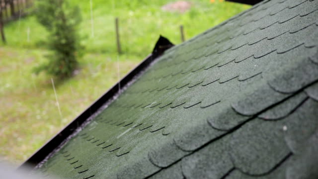 house roof during the hail storm - damaged stock videos & royalty-free footage
