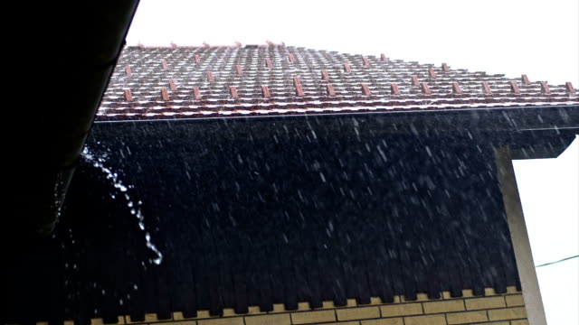 SLO MO House roof in torrential rain