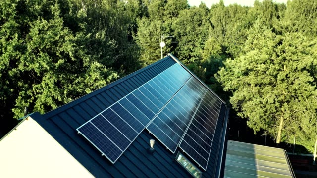 house rooftop solar power panels. - power in nature stock videos & royalty-free footage