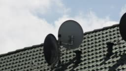 House Rooftop With Satellite Dishes