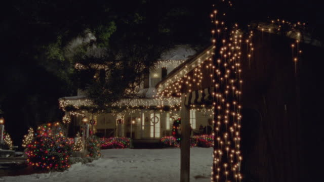 a house shining brightly with christmas lights. - outdoors stock videos & royalty-free footage