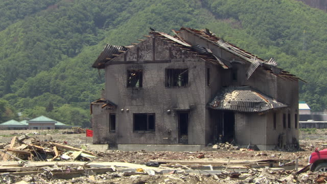 A house shows signs of heavy damage after a tsunami.