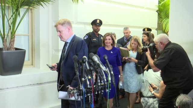 house speaker nancy pelosi walks among security and staff past news media from a caucus meeting hours after formally directing a formal impeachment... - whistleblower human role stock videos & royalty-free footage