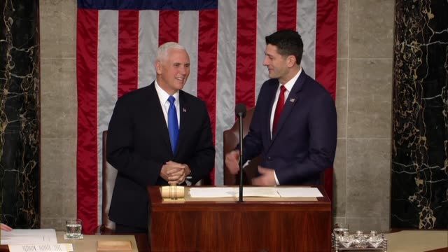 House Speaker Paul Ryan and Vice President Mike Pence converse at the chair in the House gallery prior to a joint meeting for an address by French...