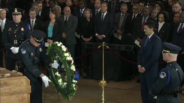 house speaker paul ryan of wisconsin accompanies a capitol policeman in laying a wreath on behalf of the house of representatives at the casket of... - first lady stock-videos und b-roll-filmmaterial