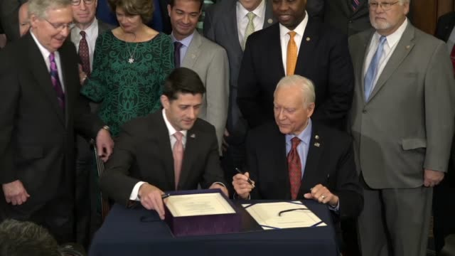 house speaker paul ryan of wisconsin is joined by senate finance committee chairman orrin hatch of utah to sign the enrolled tax cuts and jobs act... - republikanische partei der usa stock-videos und b-roll-filmmaterial