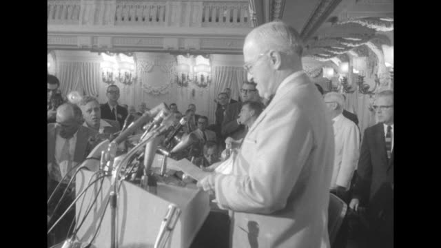 house speaker sam rayburn and socialite perle mesta pose for photos together at reception / mesta with adlai stevenson / crowd of people at reception... - sam rayburn video stock e b–roll