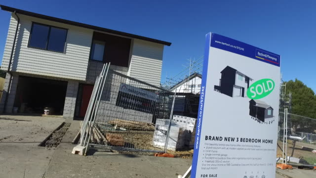 house under construction in glen innes auckland with sold real estate sign outside on site of former state house - real estate sign stock videos & royalty-free footage