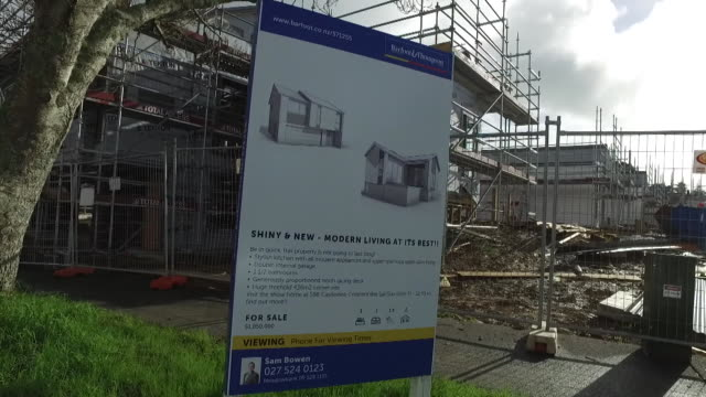 house under construction with for sale real estate sign asking price over one million dollars on site of former state house in glen innes auckland - real estate sign stock videos & royalty-free footage