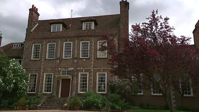 house used in downton abbey up for sale; england: surrey: ext gv byfleet manor int reporter being shown round inside house - stately home stock videos & royalty-free footage
