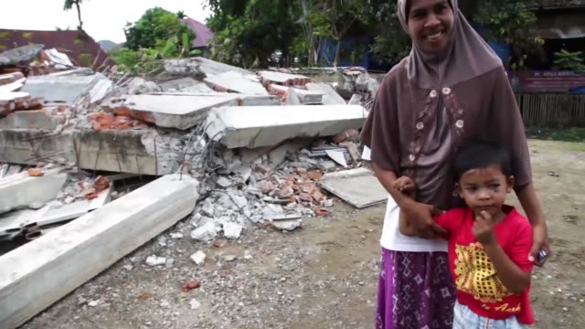 A house was devastated destroyed after 65 Earth Quake hit Pidijaya Village at Trenggaleng District When the earth quake happening for over 35 second...