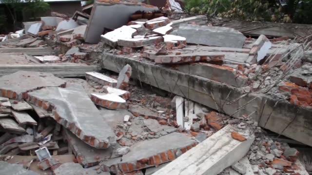 vídeos y material grabado en eventos de stock de a house was devastated destroyed after 65 earth quake hit pidijaya village at trenggaleng district when the earth quake happening for over 35 second... - isla de sumatra