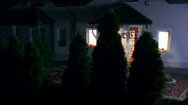 HD CRANE: House With Halloween Decorations At Night