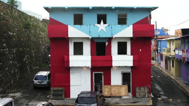 house with puerto rican flag damaged by hurricane maria in la perla, san juan, puerto rico - puerto rico stock videos & royalty-free footage