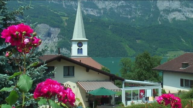 ws tu house with small clock steeple in alps / near zurich, switzerland - steeple stock videos & royalty-free footage