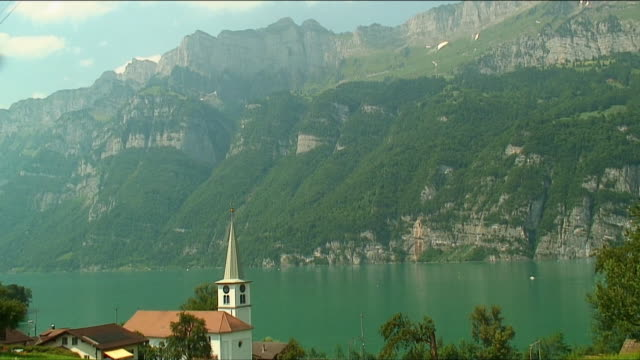 ws ha house with small clock steeple in alps / near zurich, switzerland - establishing shot stock videos & royalty-free footage