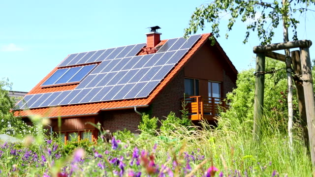 house with solar panels - roof stock videos & royalty-free footage