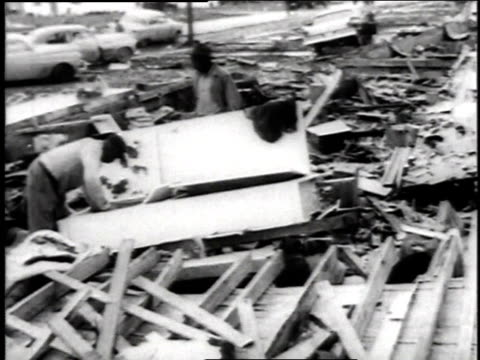 house without a roof / men searching through rubble from demolished building / people standing in rubble / dog standing in rubble - 1957 stock videos & royalty-free footage