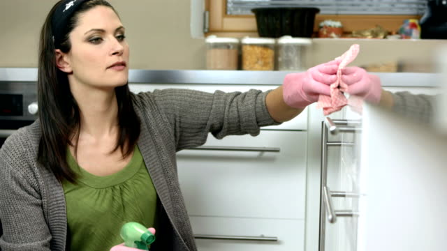 hd: housecleaner cleaning the kitchen - protective glove stock videos & royalty-free footage