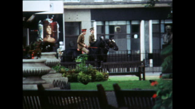 household calvalry soldiers ride horses through london streets; 1975 - moving past stock videos & royalty-free footage