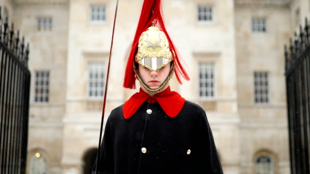 a household cavalry guard stands on duty on march 01 2018 in london united kingdom people have been warned to not to make unnecessary journeys as the... - honour guard stock videos & royalty-free footage