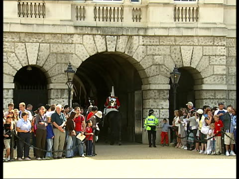 household cavalry in london household cavalry on horse guards parade / household cavalry on horseback in single file through archway out of parade... - horse guards parade stock videos and b-roll footage